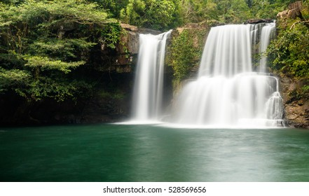 Klong Chao waterfall cascades serenely into the tranquil green pool below, in the interior of the island of Koh Kood, Thailand.