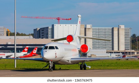 Kloten, Switzerland - September 29, 2016: a Dassault Falcon 7X airplane at Zurich airport. The Dassault Falcon 7X is a large-cabin business jet manufactured by the Dassault Aviation company.