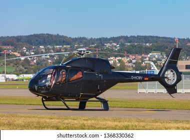 Kloten, Switzerland - September 30, 2016: a Eurocopter EC 120B Colibri helicopter at Zurich airport. The Eurocopter EC 120B Colibri is a five-seat single-engine light utility helicopter.