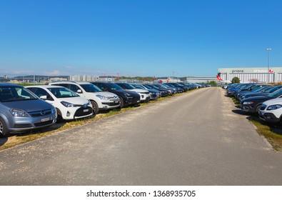 Kloten, Switzerland - September 30, 2016: a parking lot at Zurich Airport. Zurich Airport, also known as Kloten Airport, is the largest airport in Switzerland.