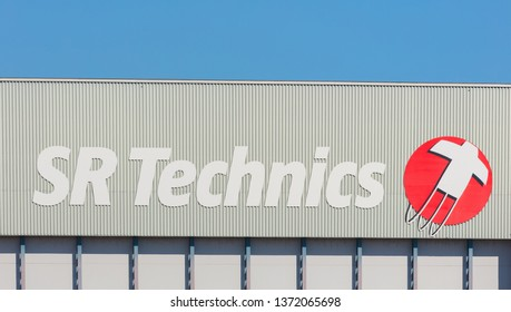 Kloten, Switzerland - September 30, 2016: a building at the Zurich Airport bearing the sign of the SR Technics company. The SR Technics is a world leading service provider for civil aviation.
