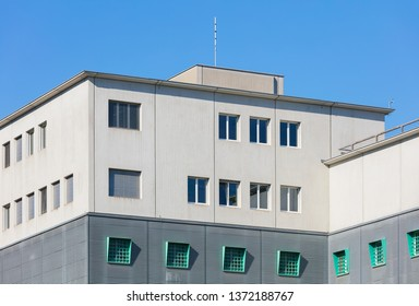 Kloten, Switzerland - September 30, 2016: upper part of the building of the Zurich Airport Prison, which is an extradition and remand prison, located in the territory of the Zurich Airport.