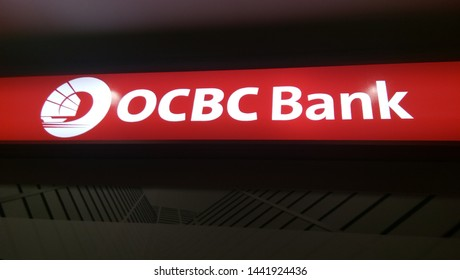 Kluang, Johor / Malaysia - July 04, 2019 : OCBC Oversea Chinese Banking Corporation is a financial services organisation. Night view. Image contain grain and soft focus.
