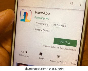 Kluang, Johor / Malaysia - July 20, 2019 : FaceApp (portrait editor) for download showned on Play Store apps for Android smartphone. Mobile device technology concept. Image contain grain and softfocus