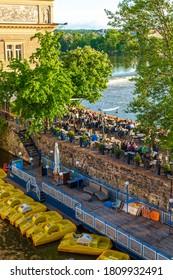 Klub Lavka restaurant in Prague. People are resting on a summer terrace overlooking the Vltava River. Prague / Czechia - 05.21.2019
