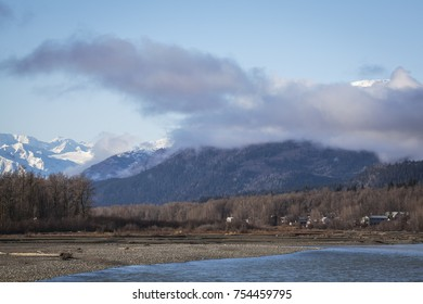 Klukwan Native Indian village on the shore of the Chilkat River in Southeast Alaska in fall.