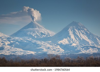 The Klyuchevskaya volcano erupts, an active stratovolcano in the east of the Kamchatka Peninsula. Nearby is the Kamen volcano.  - Shutterstock ID 1984760564