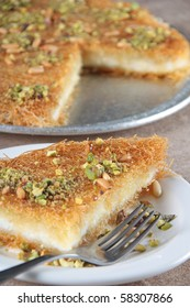 Knafeh in plate with fork - close up shot