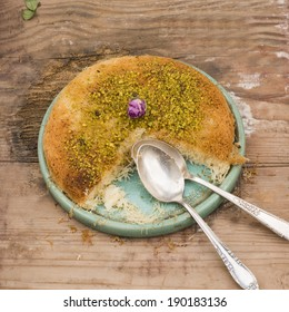 Knafeh in plate with two spoons - close up shot