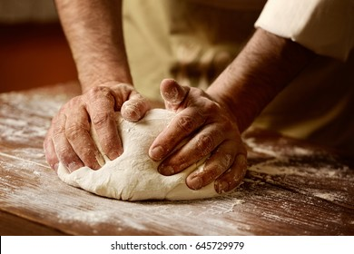 kneading and making bread dough