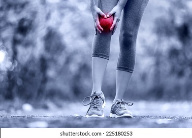 Knee Injury - sports running knee injuries on woman. Female runner with pain from sprain knee. Close up of legs, muscle and knee outdoors.
