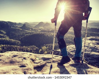 Knee joint hurt within trek. Tourist man suffering from knee pain in mountain hike.