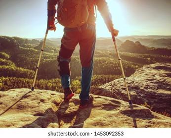 Knee joint hurt within trek. Tourist man suffering from knee pain in mountain hike.