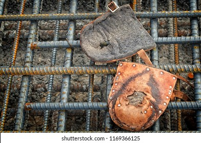 Knee pads worn by steel workers on a bridge deck while tying steel reinforcing bars together with a small diameter wire prior to pouring concrete on the bridge deck to provide strength and integrity