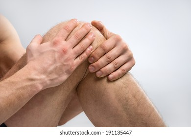 Knee Pain. Man suffering from knee pain.
