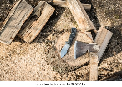knife and ax on firewood background
