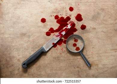 Knife with blood on the floor, halloween bloody murder or death crime murderer concept.