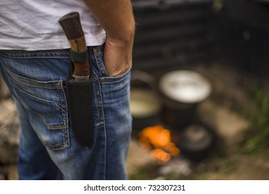 knife in the case attached to the human strap close-up. a man carries a dagger in his holster with his hand in his pocket. security for tourists cold steel from a predator. - Shutterstock ID 732307231