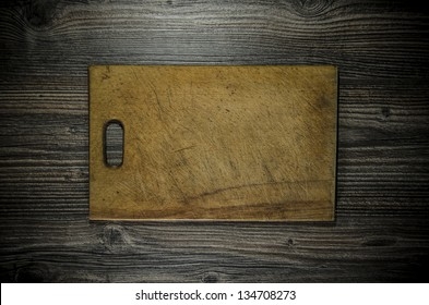 knife and cutting board used condition stylized
