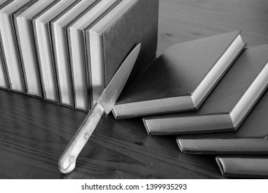 knife cutting slices of books, black and white
