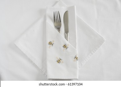 Knife and Fork with embroidered Bee linen napkin and tablecloth
