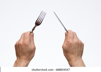 Knife and fork in hands on a white background