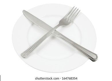 Knife and Fork on Plate with White Background