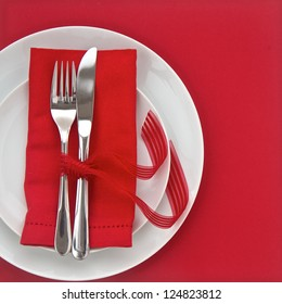 Knife and Fork with pink table setting  for Valentines Day