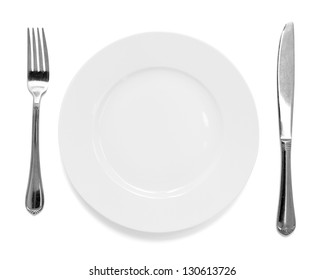 knife and fork with plate isolated on white background