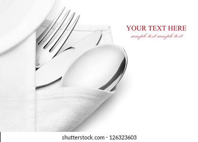 Knife, fork and spoon with linen serviette, isolated on the white background, clipping path included.