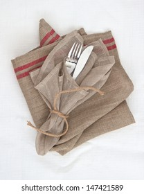 Knife and fork table setting with natural fabrics