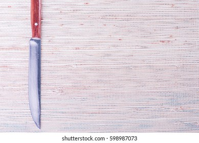 Knife, kitchen utensil sharp metal tool with blade and handle. Food stainless equipment for cut, cook, butcher, chef. Closeup silver object.  White, blue background.
