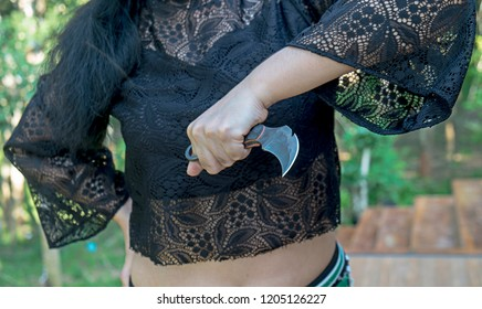 Knife in lady hands, karambit knife tactical fighter, self defense Martial Arts Fighting