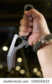 knife multitool turned into pliers in the hands of a man