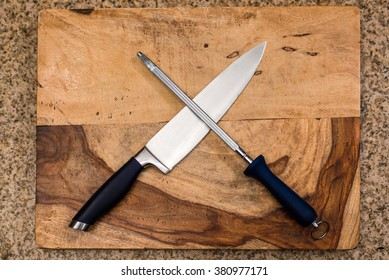 Knife & Sharpener On A Cutting Board