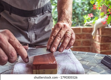 Knife sharpening with a whetstone.