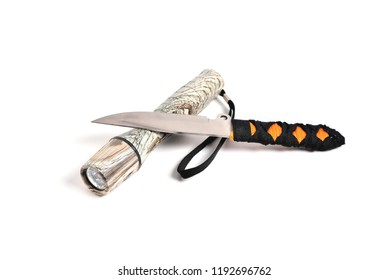 knife for throwing and hand-held flashlight white background close-up