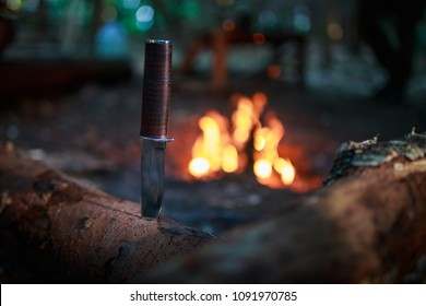 knife in wood by fire