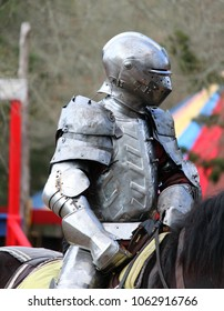 A Knight In Armor Preparing for a Joust