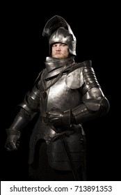 Knight in armour after battle on the black background