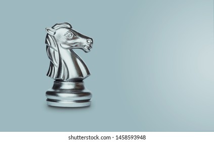 Knight chess isolated on gray background with clipping path and copy space.