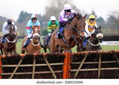 Knight In Dubai (IRE) ridden by Harry Skelton and trained by Dan Skelton jumps the last fence in the 188Bet EBF NH Novices Race. Market Rasen Racecourse, Lincs, UK : 6 February 2018 : Pic Mick Atkins