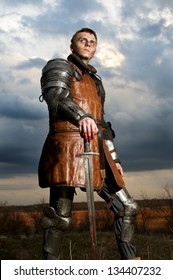 Knight holding sword on a sky background