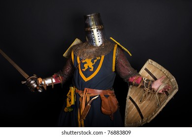 Knight is holding a sword and shield