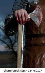 Knight holds a bloody axe