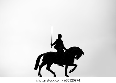 Knight with horse silhouette.