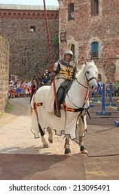 Knight. Knightly tournament in old castle in Vyborg (Russia) 26 july 2014.