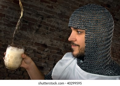 Knight looking at glass of bear and waiting to drink it