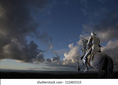 Knight on horseback, against the clouds, with lance