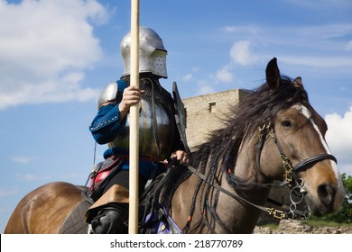 Knight on horseback over blue sky background